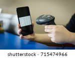 a barcode scanner scanning a...