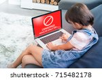 Little girl reacts while using a laptop and watching inappropriate content, internet safety concept,  censored only adult 18+ on screen - stock photo