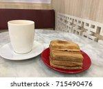 kaya toast and hot milk tea ... | Shutterstock . vector #715490476