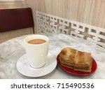 kaya toast and hot milk tea ... | Shutterstock . vector #715490536