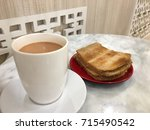 kaya toast and hot milk tea ... | Shutterstock . vector #715490542