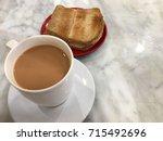 kaya toast and hot milk tea ... | Shutterstock . vector #715492696