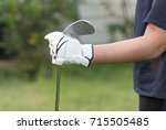 golfer wearing white glove... | Shutterstock . vector #715505485