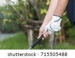 golfer wearing white glove... | Shutterstock . vector #715505488