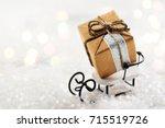 small gift box on white sledge. ... | Shutterstock . vector #715519726