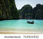 a motorboat on the sea in koh... | Shutterstock . vector #715521922