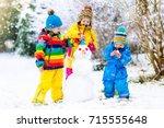children build snowman. kids...   Shutterstock . vector #715555648