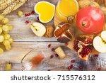 autumn harvest concept   fruits ... | Shutterstock . vector #715576312