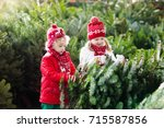 family selecting christmas tree.... | Shutterstock . vector #715587856