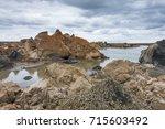 giant crater of unknown origin... | Shutterstock . vector #715603492