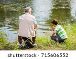 grandfather and grandson are... | Shutterstock . vector #715606552