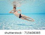 happy small boy posing... | Shutterstock . vector #715608385