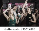 colleagues dancing on corporate ... | Shutterstock . vector #715617382