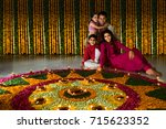 family sitting near rangoli | Shutterstock . vector #715623352