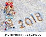 christmas cookies on snowy... | Shutterstock . vector #715624102