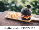charcoal burger made with black ... | Shutterstock . vector #715629112