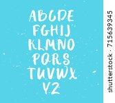 calligraphic font. handwritten... | Shutterstock .eps vector #715639345