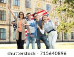 group of students holding flag... | Shutterstock . vector #715640896
