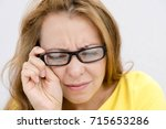 closeup portrait  mature woman... | Shutterstock . vector #715653286
