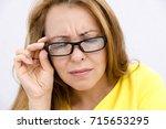 mature woman with black eye...   Shutterstock . vector #715653295