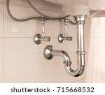 basin siphon or sink drain in a ... | Shutterstock . vector #715668532