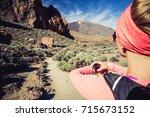 trail running woman on mountain ... | Shutterstock . vector #715673152