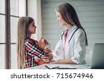 little cute girl with plush toy ... | Shutterstock . vector #715674946