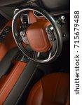 car interior driving wheel | Shutterstock . vector #715679488