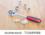 block wrench on wooden table... | Shutterstock . vector #715689088