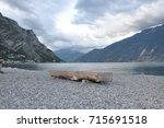 single stone bench on shore of...   Shutterstock . vector #715691518