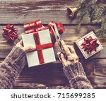 preparing a new year's gift at... | Shutterstock . vector #715699285