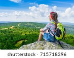 young travel girl sitting on...   Shutterstock . vector #715718296