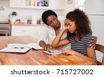 mother helps stressed teenage... | Shutterstock . vector #715727002