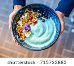 Small photo of Blue magic bowl, smoothie bowl, with granola and fruit.
