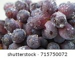 ripe red wet grape with drops.... | Shutterstock . vector #715750072