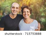 mature mother and young son... | Shutterstock . vector #715753888