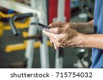 man using smart phone in... | Shutterstock . vector #715754032