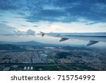 clouds and sky as seen through... | Shutterstock . vector #715754992
