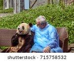 giant panda cub sitting on a... | Shutterstock . vector #715758532