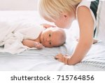 brother kissing his little... | Shutterstock . vector #715764856