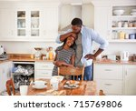 daughter helping father to...   Shutterstock . vector #715769806