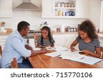 father helping two daughters... | Shutterstock . vector #715770106