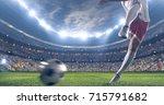 soccer player kicks the ball on ... | Shutterstock . vector #715791682