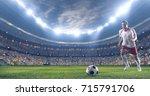 soccer player kicks the ball on ...   Shutterstock . vector #715791706