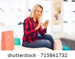 young blonde smiling attractive ... | Shutterstock . vector #715861732