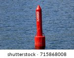 Small photo of A spar buoy floats in the waters of Lake Ontario in Canada