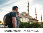 a pair of travelers near the... | Shutterstock . vector #715874866