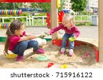 conflict on the playground. two ... | Shutterstock . vector #715916122