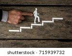 successful businessman climbing ... | Shutterstock . vector #715939732