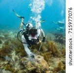 marine biologist surverying sea ... | Shutterstock . vector #715977076
